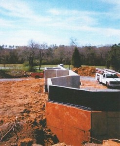 Waterproofing partially exposed concrete wall