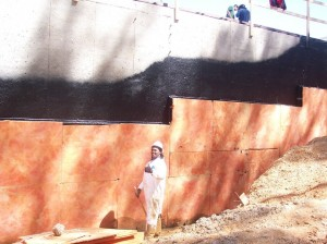 Waterproofing a retaining wall